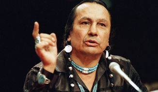 Russell Means, a leader of the American Indian Movement organization, testifies before a special Senate investigative committee on Capitol Hill in Washington in 1989. (AP Photo/Marcy Nighswander)