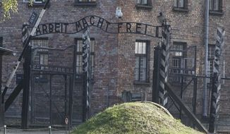 "The entrance with the inscription ""Arbeit Macht Frei"" (Work Sets You Free) gate of the former German Nazi death camp of Auschwitz is seen at the Auschwitz-Birkenau memorial in Oswiecim, Poland, Friday, Oct. 19, 2012. (AP Photo/Czarek Sokolowski)"