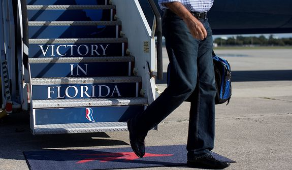 Republican presidential candidate, former Massachusetts Gov. Mitt Romney steps off his campaign plane at Palm Beach International Airport, Saturday, Oct. 20, 2012, in Daytona Beach, Fla.  (AP Photo/ Evan Vucci)