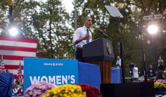 President Barack Obama speaks about the choice facing women in the upcoming election, Friday, Oct. 19, 2012, at a campaign event at George Mason University in Fairfax, Va. (AP Photo/Carolyn Kaster)