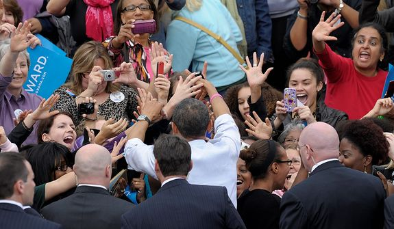 President Barack Obama is surrounded by Secret Service agents as he greets women who were on the riser behind him, after he spoke about choice facing women in the election during a campaign event at George Mason University, in Fairfax, Va., Friday, Oct. 19, 2012. (AP Photo/Susan Walsh)