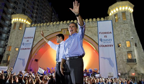 Republican presidential candidate, former Massachusetts Gov. Mitt Romney, right, and vice presidential running mate Rep. Paul Ryan, R-Wis., wave to the crowd during a campaign rally on Friday, Oct. 19, 2012 in Daytona Beach, Fla.  (AP Photo/ Evan Vucci)