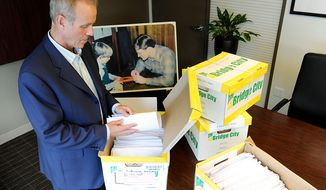 Portland attorney Kelly Clark examines Oct., 16, 2012, in his office in Portland, Ore., some of the 14,500 pages of previously confidential documents created by the Boy Scouts of America concerning child sexual abuse within the organization. The documents were released two days later, despite The Boy Scouts of America's fight to keep those files confidential. (Associated Press)