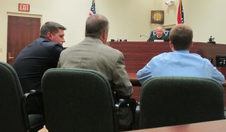 **FILE** Warren County Juvenile Court Judge Mike Powell warns 17-year-old Ohio high school student Tyler Pagenstecher (right) of the consequences of admitting guilt at his first hearing in Lebanon, Ohio, on July 31, 2012. Police say Pagenstecher played a major role in a drug ring that sold as much as $20,000 worth of high-grade marijuana a month to fellow students at two high schools. (Associated Press)