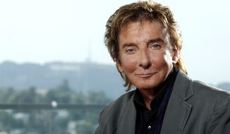 Musician Barry Manilow poses for a portrait in Los Angeles in June 2011. The singer-songwriter will be back on Broadway in January for a limited engagement. (AP Photo/Matt Sayles)