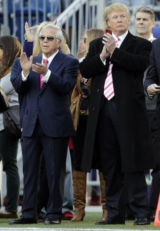 New England Patriots owner Robert Kraft, left, and businessman Donald Trump, right, applaud on the field before an NFL football game between the Patriots and the New York Jets in Foxborough, Mass., Sunday, Oct. 21, 2012. (AP Photo/Charles Krupa)