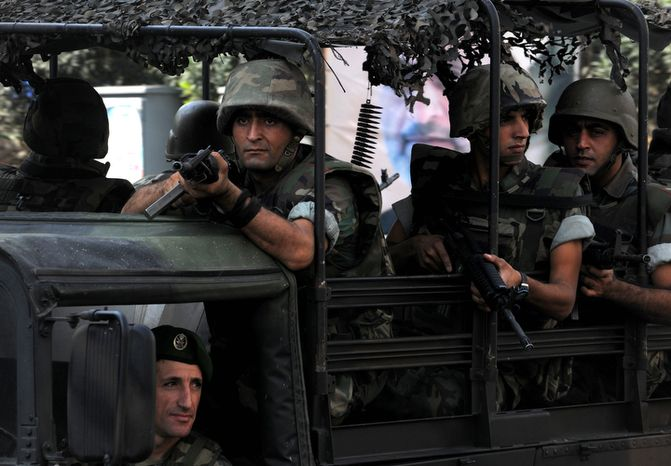 Lebanese Army soldiers patrol a neighborhood after overnight clashes between Sunni and Shiite gunmen in Beirut on Oct. 22, 2012. (Associated Press)