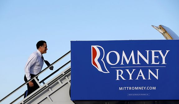 Republican presidential candidate Mitt Romney boards his campaign plane in West Palm Beach, Fla., on Tuesday, Oct. 23, 2012, en route to a campaign stop in Nevada, after the final presidential debate Monday night with President Obama. (AP Photo/David Goldman)