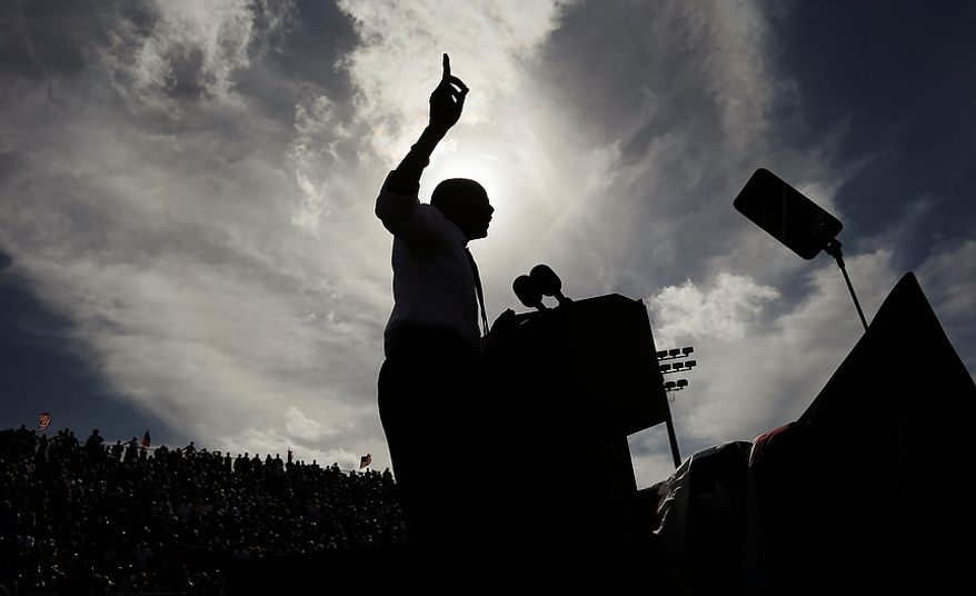 A silhouetted President Obama gestures while speaking at a campaign event at the Delray Beach Tennis Center on Tuesday, Oct. 23, 2012, in Delray Beach, Fla. The president is making campaign stops in Florida and Ohio today. (AP Photo/Pablo Martinez Monsivais)