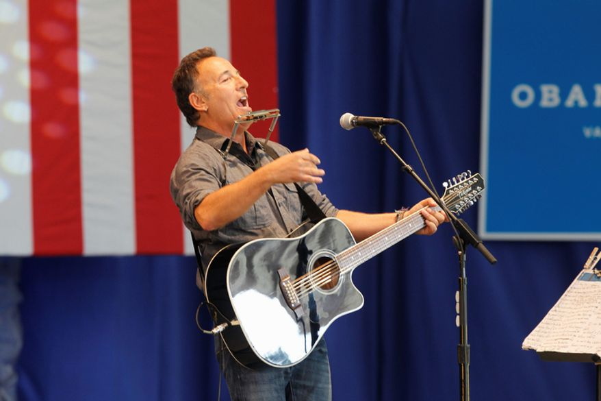 Bruce Springsteen ralliesw support for President Barack Obama during a free concert held Tuesday afternoon Oct. 23, 2012 at the nTelos Wireless Pavilion in Charlottesville, Va. (AP Photo/The Daily Progress/Andrew Shurtleff)