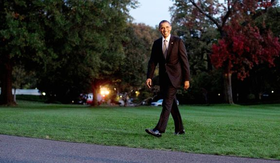 President Barack Obama walks across the South Lawn to the White House from Marine One, Tuesday, Oct. 23, 2012, in Washington. (AP Photo/Carolyn Kaster)
