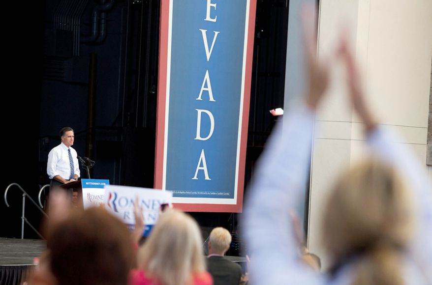 Republican presidential candidate Mitt Romney pauses as the crowd reacts while speaking to supporters during a rally, Tuesday, Oct. 23, 2012, in Henderson, Nev. Fresh off the presidential debate in Florida, Romney and running mate Paul Ryan were making their first joint appearance in Nevada before heading to another campaign stop in Denver. (Associated Press)