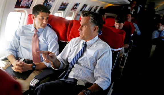 Republican presidential candidate, former Massachusetts Gov. Mitt Romney, right, and his vice presidential running mate, Rep. Paul Ryan, R-Wis., talk aboard their campaign plane en route from Las Vegas to a campaign event in Denver, Tuesday, Oct. 23, 2012. (AP Photo/David Goldman)