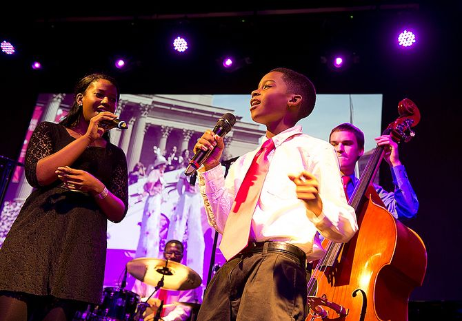 From left, Integriti Reeves, artist-in-residence with the D.C. Jazz Festival Education Program, Cedric Edmon, a student at Howard University, Larquette Brown, 12, with the Boys and Girls Club Teen Arts Program (TAP) and Elliot Seppa, a student at Howard University, perform at the National Cherry Blossom Festival launch luncheon at Hamilton Live in Washington, D.C. on Tuesday, Oct. 22, 2012. The event included about 200 people, both sponsors and potential sponsors. (Barbara L. Salisbury/The Washington Times)