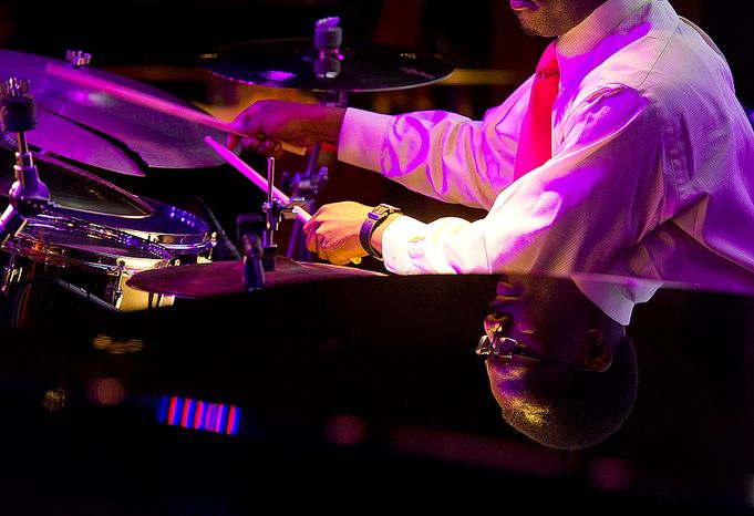 Cedric Edmon, a student at Howard University, plays drums during the National Cherry Blossom Festival launch luncheon at the Hamilton Live in Washington, D.C. on Tuesday, Oct. 23, 2012. Mayor Vincent Gray also spoke, and former American Idol contestant and recording artist Elliott Yamin, who is one of the 2013 festival celebrity ambassadors, performed as well. (Barbara L. Salisbury/The Washington Times)