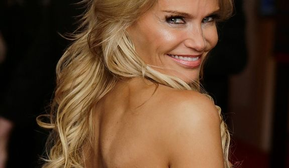 Actress Kristin Chenoweth poses for photographers on the red carpet before entertainer Ellen DeGeneres receives the 15th annual Mark Twain Prize for American Humor at the Kennedy Center, Monday, Oct. 22, 2012, in Washington. (AP Photo/Alex Brandon)