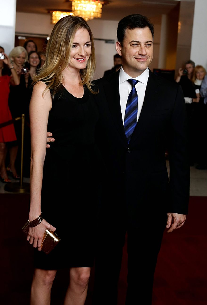 Entertainer Jimmy Kimmel, right, with his fiancee Molly McNearney, pose for photographers on the red carpet before entertainer Ellen DeGeneres receives the 15th annual Mark Twain Prize for American Humor at the Kennedy Center, Monday, Oct. 22, 2012, in Washington. (AP Photo/Alex Brandon)