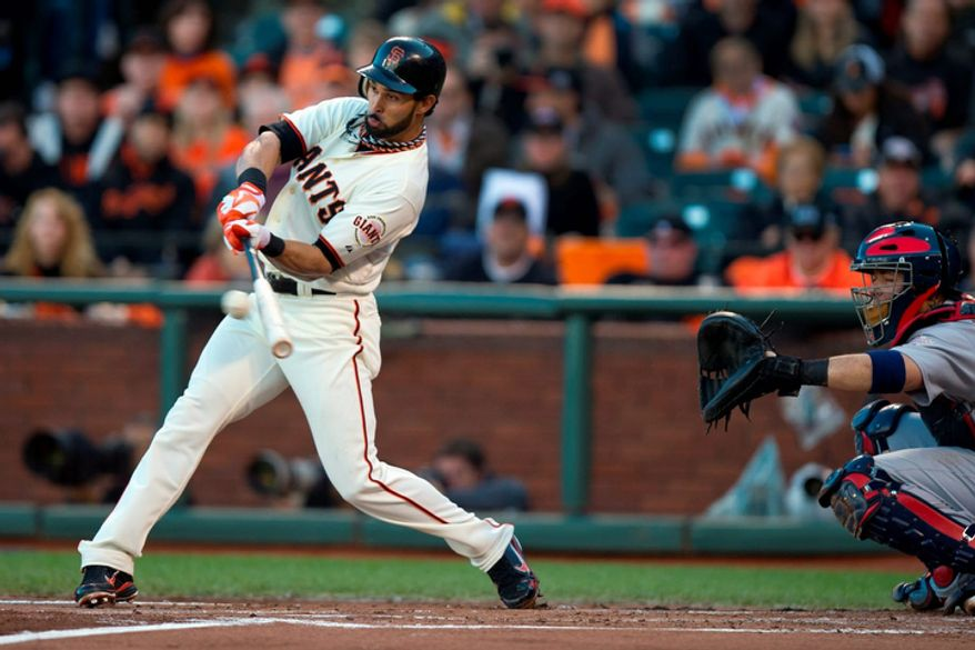 San Francisco Giants CF Angel Pagan singles against the St. Louis Cardinals during the first inning of Game 7 of the National League Championship Series on Oct. 22, 2012, in San Francisco. (Associated Press/The Sacramento Bee)