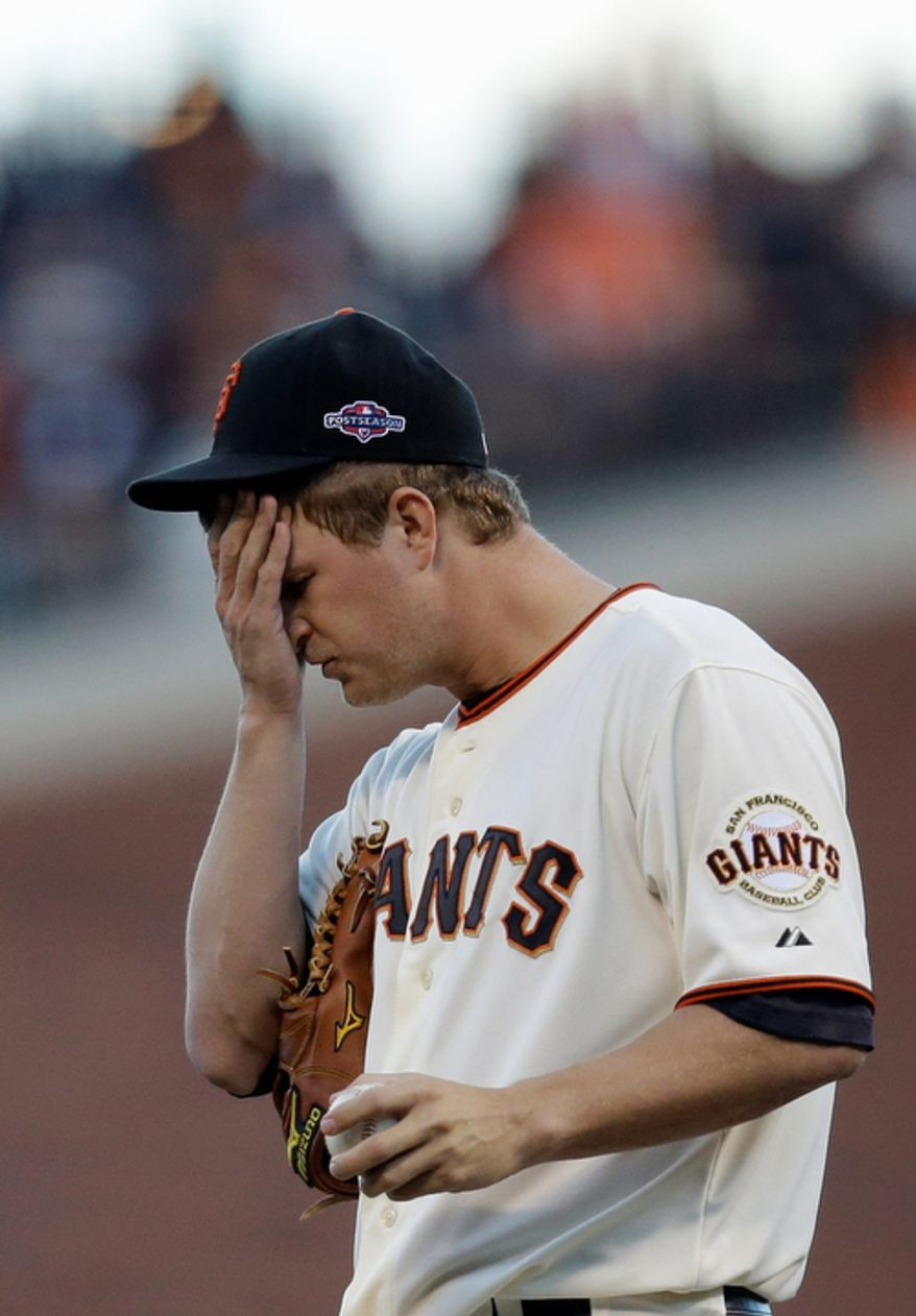 San Francisco Giants starting pitcher Matt Cain reacts after walking St. Louis Cardinals 3B David Freese in the second inning of Game 7 of the National League Championship Series on Oct. 22, 2012, in San Francisco. (Associated Press/The Sacramento Bee)
