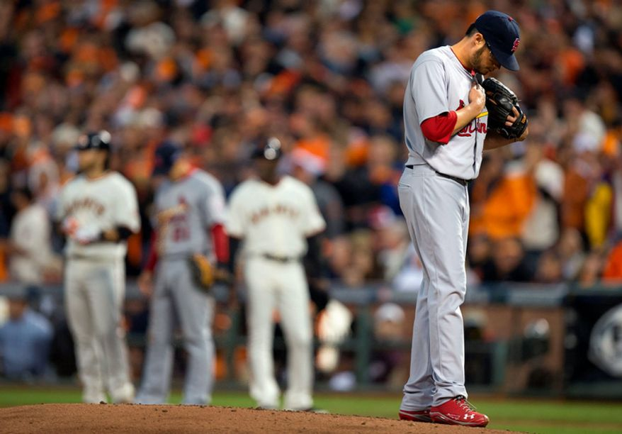 St. Louis Cardinals pitcher Joe Kelly stands on the mound during the third inning of Game 7 of the National League Championship Series between the Cardinals and the San Francisco Giants on Oct. 22, 2012, in San Francisco. (Associated Press/The Sacramento Bee)