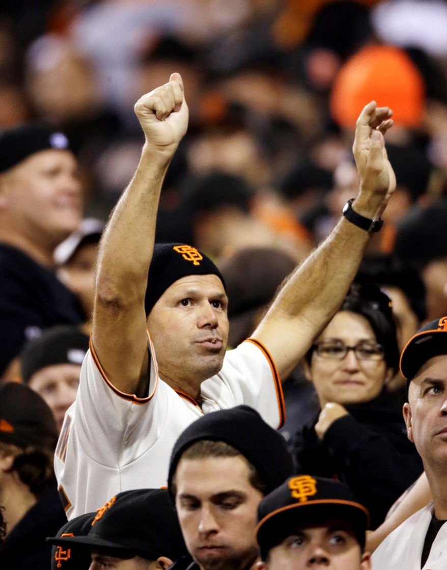 A San Francisco Giants fan cheers during the third inning of Game 7 of the National League Championship Series between the Giants and the St. Louis Cardinals on Oct. 22, 2012, in San Francisco. (Associated Press)