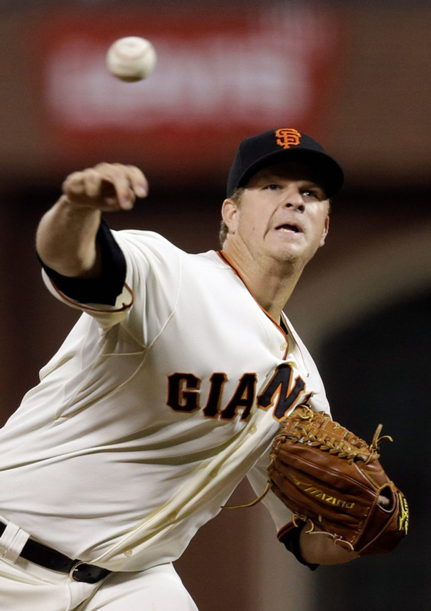 San Francisco Giants starting pitcher Matt Cain throws during the sixth inning of Game 7 of the National League Championship Series between the Giants and the St. Louis Cardinals on Oct. 22, 2012, in San Francisco. (Associated Press)