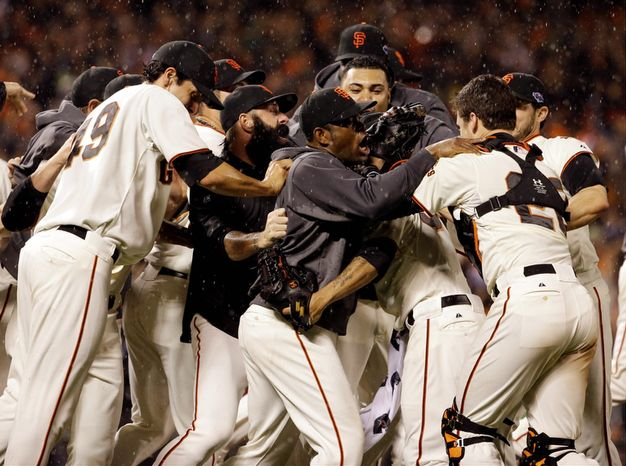 The San Francisco Giants celebrate after the final out in Game 7 of the National League Championship Series between the Giants and the St. Louis Cardinals on Oct. 22, 2012, in San Francisco. The Giants won 9-0 to win the series. (Associated Press)