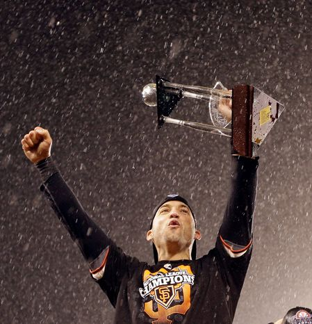 San Francisco Giants 2B Marco Scutaro celebrates after Game 7 of the National League Championship Series between the Giants and the St. Louis Cardinals on Oct. 22, 2012, in San Francisco. The Giants won 9-0 to win the series. Scutaro was named the series MVP. (Associated Press)