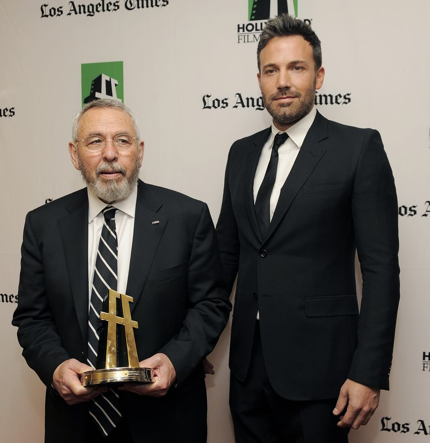 """Ben Affleck (right), a cast member and director of the film """"Argo,"""" poses with former CIA agent Tony Mendez, whom Mr. Affleck portrays in the film, backstage at the 16th annual Hollywood Film Awards gala on Monday, Oct. 22, 2012, in Beverly Hills, Calif. (Chris Pizzello/Invision/AP)"""