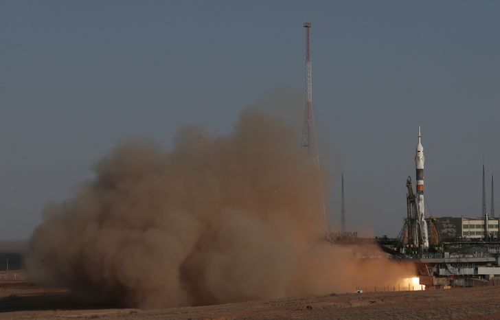 A Soyuz-FG rocket booster with Soyuz TMA-06M space ship carrying a new crew to the International Space Station blasts off from the Russian-leased Baikonur