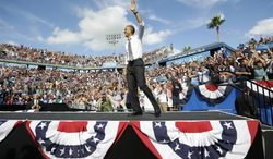 President Obama greets the crowd as he takes the stage at a campaign event at the Delray Beach Tennis Center on Tuesday, Oct. 23, 2012, in Delray Beach, Fla., a day after the final presidential debate against Republican nominee Mitt Romney. (AP Photo/Pablo Martinez Monsivais)