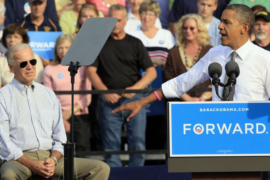 President Obama thanks Vice President Joe Biden (left) during a joint campaign appearance Oct. 23, 2012, at Triangle Park in Dayton, Ohio. (Associated Press)