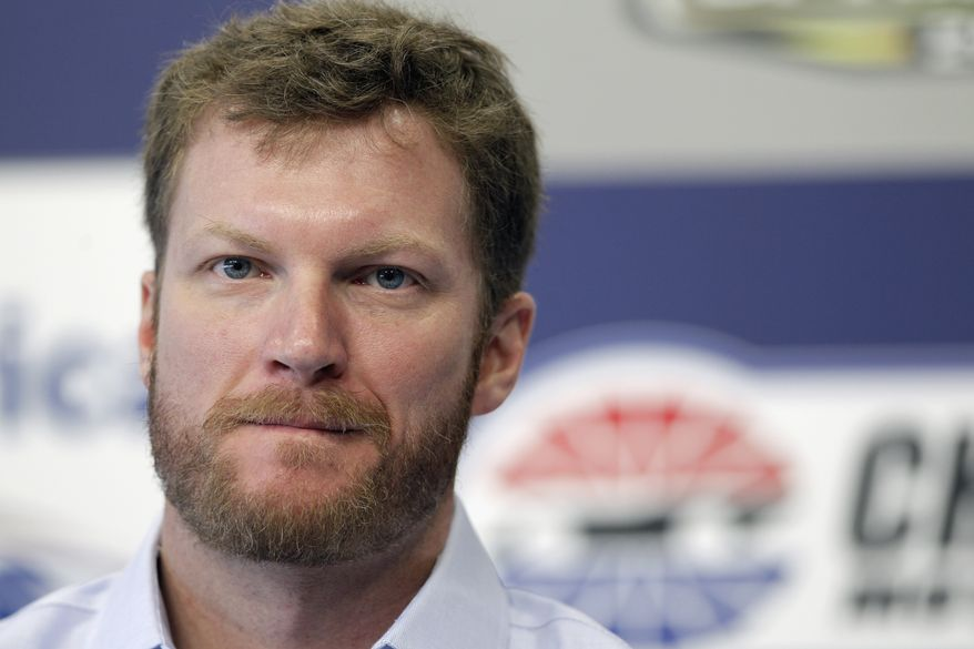 Dale Earnhardt Jr. pauses as he talks about missing the next two races with his second concussion in the past six weeks  during a news conference prior to practice for Saturday's NASCAR Bank of America 500 NASCAR Sprint Cup series auto race in Concord, N.C., Thursday, Oct. 11, 2012. (AP Photo/Chuck Burton)