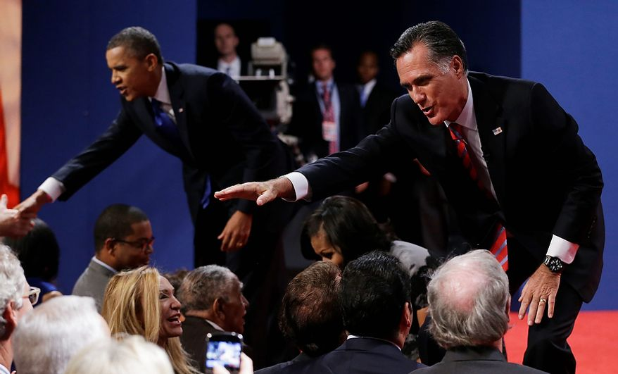 Republican presidential nominee Mitt Romney, right, and President Barack Obama shake hands with audience members following the third presidential debate at Lynn University, Monday, Oct. 22, 2012, in Boca Raton, Fla. (AP Photo/Eric Gay)