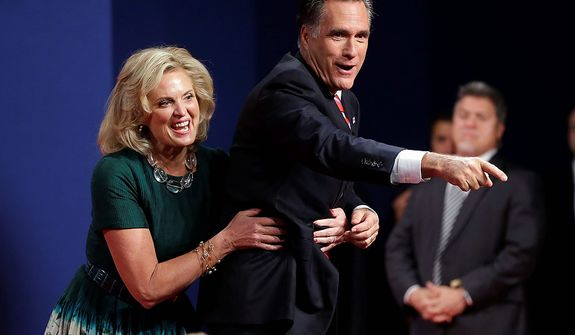 Ann Romney, wife of Republican presidential candidate, former Massachusetts Gov. Mitt Romney, laughs as she pulls her husband away from the edge of the stage after the third presidential debate with President Barack Obama at Lynn University, Monday, Oct. 22, 2012, in Boca Raton, Fla. (AP Photo/Pablo Martinez Monsivais)