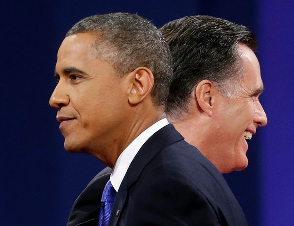 **FILE** President Obama (left) and Republican presidential candidate Mitt Romney walk past each other onstage Oct. 22, 2012, at the end of the final presidential debate at Lynn University in Boca Raton, Fla. (Associated Press)