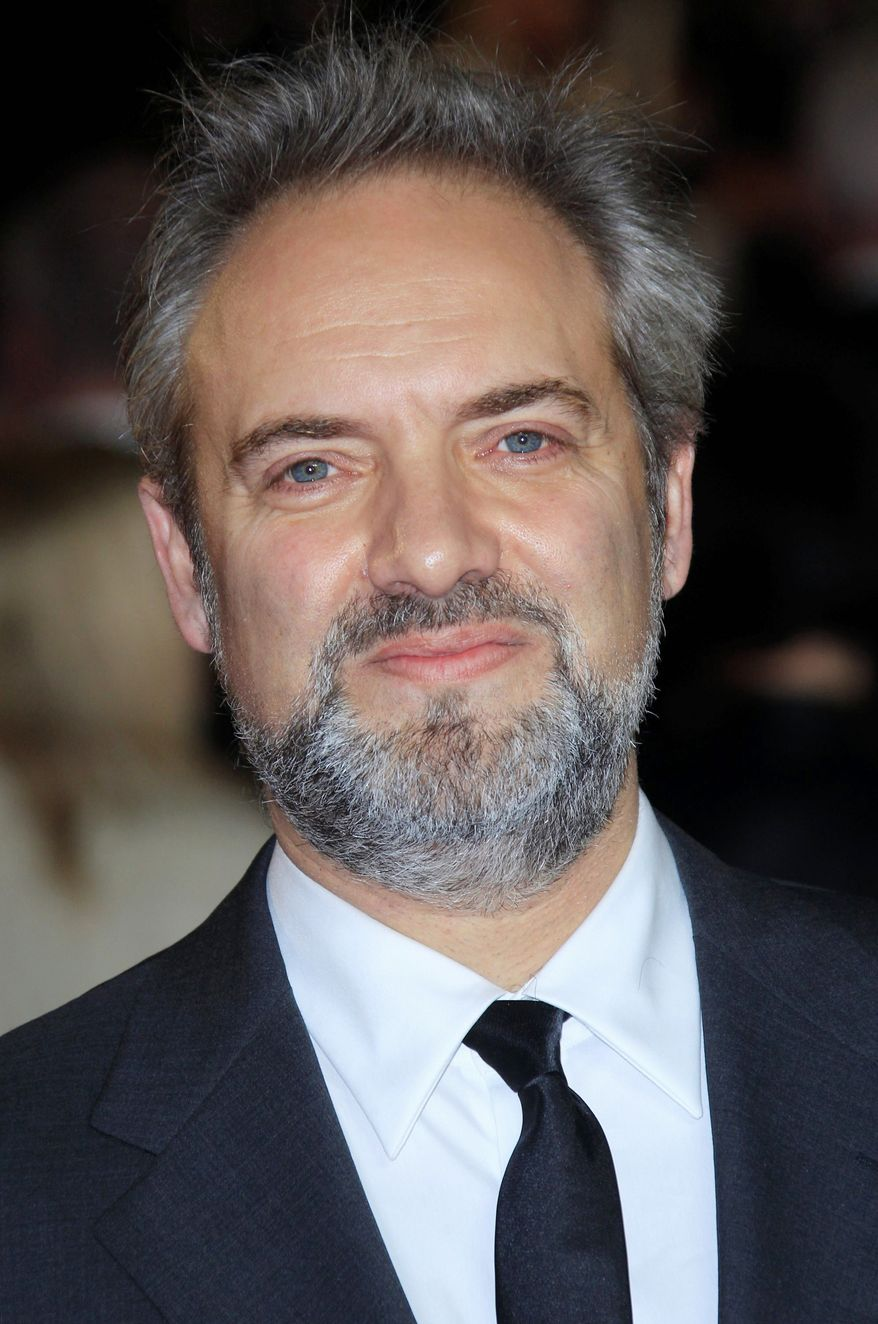 """Director Sam Mendes arrives at the world premiere of """"Skyfall"""" at the Royal Albert Hall on Tuesday, Oct. 23, 2012 in London. (Photo by Joel Ryan/Invision/AP)"""