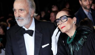 """Christopher Lee, left, and Birgit Kroencke arrive at the world premiere of """"Skyfall"""" at the Royal Albert Hall on Tuesday, Oct. 23, 2012 in London. (Photo by Joel Ryan/Invision/AP) ** FILE **"""