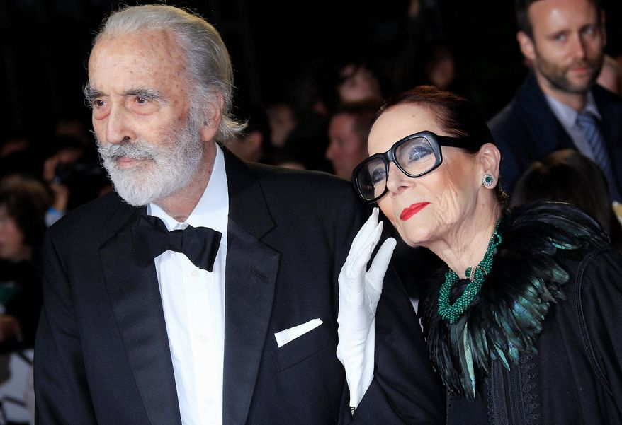 "Christopher Lee, left, and Birgit Kroencke arrive at the world premiere of ""Skyfall"" at the Royal Albert Hall on Tuesday, Oct. 23, 2012 in London. (Photo by Joel Ryan/Invision/AP) ** FILE **"