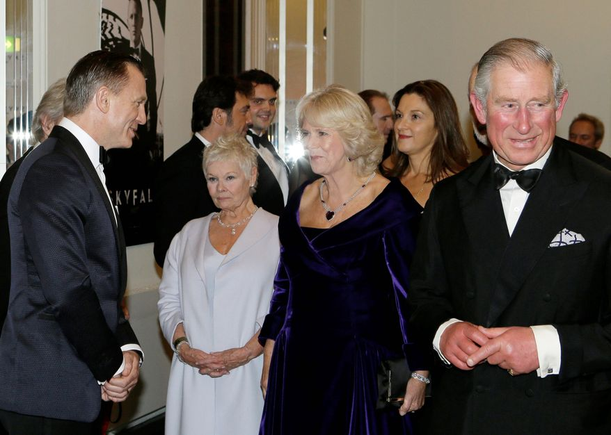 "Britain's Prince of Wales, right, and The Duchess of Cornwall, second right, meet James Bond actor Daniel Craig, left, and Dame Judi Dench, second left, as they arrive to attend the world premiere of the James Bond film, ""Skyfall"", at the Royal Albert Hall, in London Tuesday, Oct. 23, 2012. (AP Photo/Kirsty Wigglesworth, Pool)"