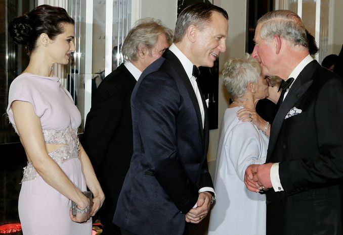 "Britain's Prince of Wales, right, talks with James Bond actor Daniel Craig, centre, with Rachel Weisz, left, as he arrives to attend the world premiere of the James Bond film, ""Skyfall"", at the Royal Albert Hall, in London Tuesday, Oct. 23, 2012. (AP Photo/Kirsty Wigglesworth, Pool)"