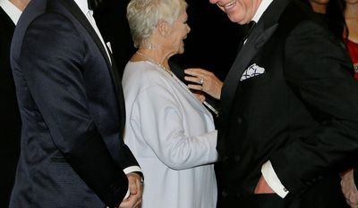 """Britain's Prince of Wales, right, laughs with James Bond actor Daniel Craig, left, as he arrive to attend the world premiere of the James Bond film, """"Skyfall"""", at the Royal Albert Hall, in London Tuesday, Oct. 23, 2012. (AP Photo/Kirsty Wigglesworth, Pool)"""