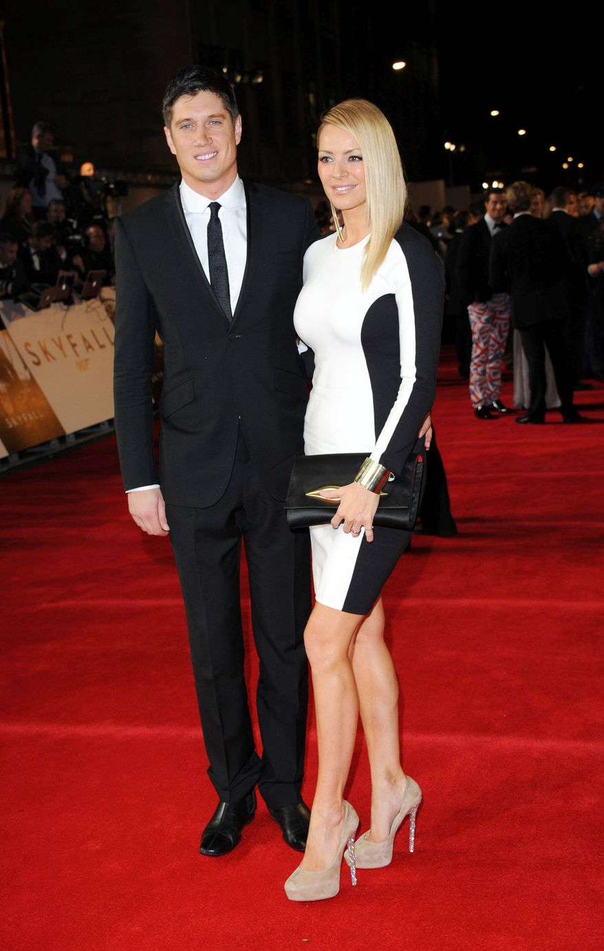 """TV presenters Vernon Kay, left, and his wife Tess Daly pose at the world premiere of """"Skyfall"""" on Tuesday, Oct. 23, 2012 in London.  (Photo by Stewart Wilson/Invision/AP)"""
