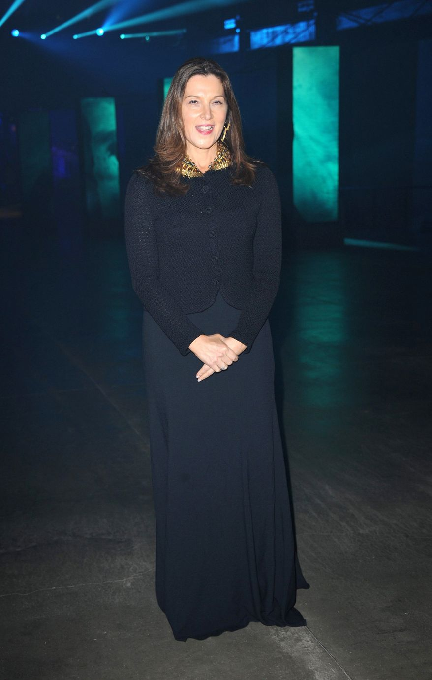 """Barbara Broccoli poses at the """"Skyfall"""" premiere after party at Tate Modern on Tuesday, Oct. 23, 2012 in London.  (Photo by Stewart Wilson/Invision/AP)"""