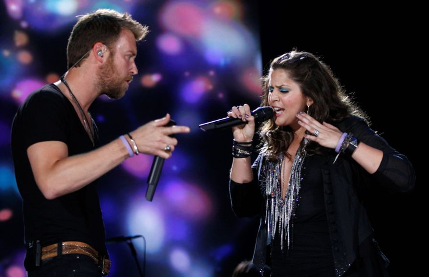 **FILE** Charles Kelley (left) and Hillary Scott of the group Lady Antebellum perform June 7, 2012, at the 2012 CMA Festival in Nashville, Tenn. (Wade Payne/Invision/Associated Press)