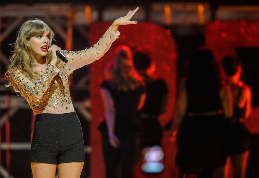 **FILE** Taylor Swift performs Sept. 22, 2012, at iHeart Radio Music Festival at the MGM Grand Arena in Las Vegas. (Eric Reed/Invision/Associated Press)