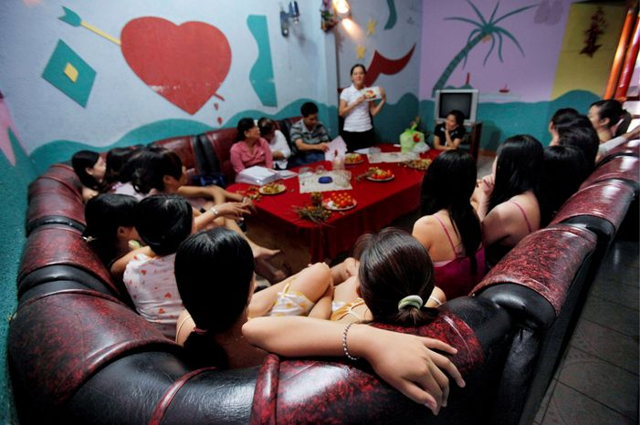 **FILE** A group of Vietnamese sex workers are given a class on safe sex by members of an HIV/AIDS outreach network at a karaoke club in Ho Chi Minh City, Vietnam, on Oct. 12, 2009. (Associated Press)