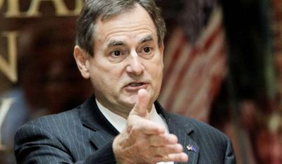 Indiana Republican Senate candidate Richard Mourdock makes a point in Indianapolis on Wednesday, at a news conference at which he sought to clarify what he meant by remarks on rape he made in a debate the night before. (Associated Press)
