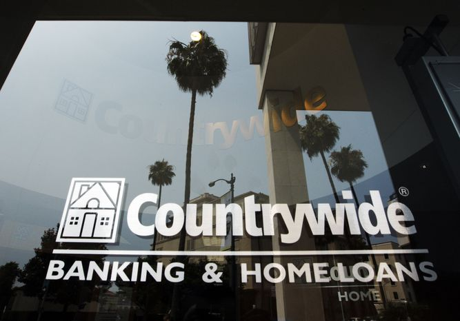 **FILE** Buildings and palm trees are reflected on the entrance of the Countrywide Financial Corp. office in Beverly Hills, Calif., on June 25, 2008. (Associated Press)