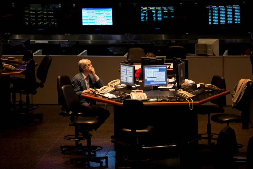 A broker works Oct. 23, 2012, at the Buenos Aires Stock Exchange in Buenos Aires. (Associated Press)